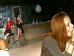 Huge party shows many clothed women watching male stripper