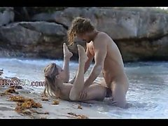 hungry art sex of horny couple on beach