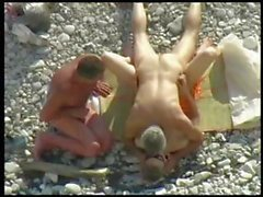 Horny threesome on the beach go for the cock sucking and banging