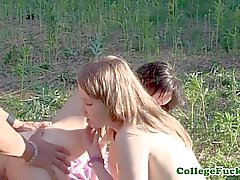 Euro college beauties share cock in forest