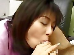 Horny housewife blows a foreign guy to get showered with cum