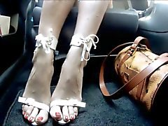 latina feet in car