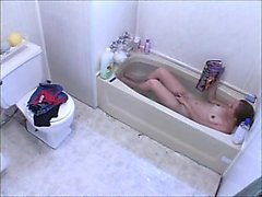 Voyeur girl masturbating in bathtub