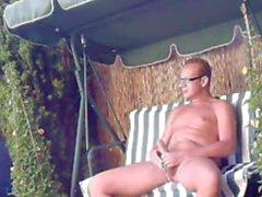german male wanks in the garden outdoor 2
