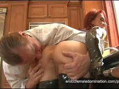 Dominatrix in a latex outfit fucked really hard in the kitchen