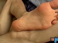 Sexy foot youngster strokes long cock passionately