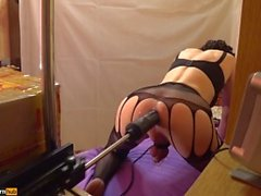 Fucking-machines fucks TS-Girl in the doggystyle, ass cum Cock Cage