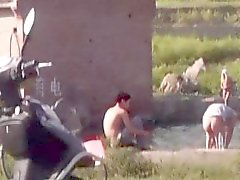 Chinese Men swimming at lake