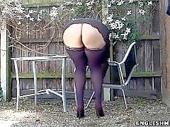 Upskirt exterior público gran culo mujer del milf en medias