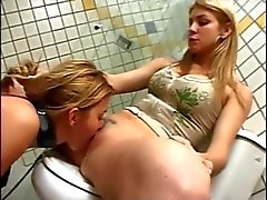 Slave licking pussy in the toilet