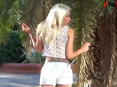 Sexy Angeles Cid shows her tranny tits outdoors!