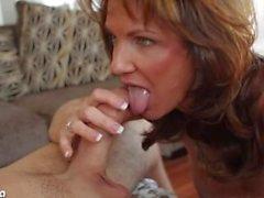 Busty brunette Deauxma blowing a big dick