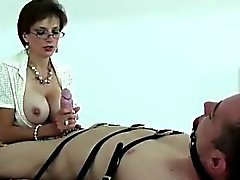 Lady Sonia ties up dude and tugs