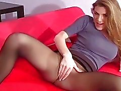Nympho exposes hairy snatch in transparent tights