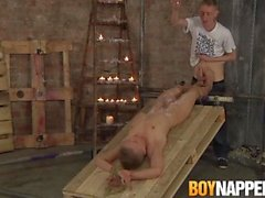 Tied up twink gives footjob to master until big cumming