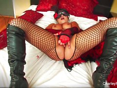 Dolled up Charley Chase plays with her pussy