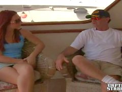 Redhead bitch Madison gives head to Josh on his boat