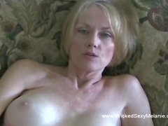 A blonde granny is hornier than ever, she masturbates and then suck on that stiff member