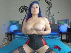 girl with luxurious big tits has fun with a sex toy