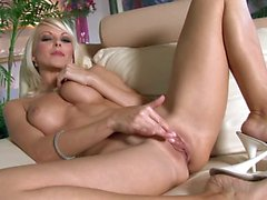 Glam blonde Jana Cova gets satisfaction alone
