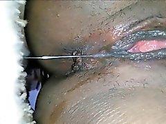 Black MILF masturbates and squirts