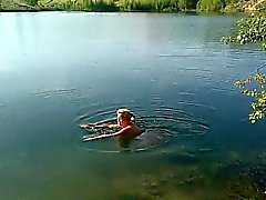 Blonde MILF is swimming naked in a lake and caught on spy c
