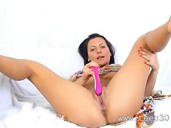 Busty babe in beads toying snatch