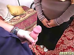Arab gal stuff a big cock in her mouth sucking it