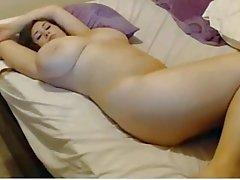 Massive tits brunette fucking herself