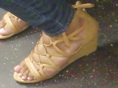 Candid ebony feet on the train