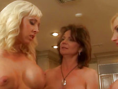Bigtitted lesbo straponfucked in threeway