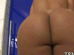 Curvy old shemale strips in a restroom