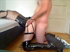 Sissy crossdresser in long boots and corset fucked in the ass by stranger