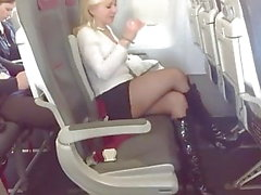 Blonde MILF Boards Airplane In Black Stockings And Boots