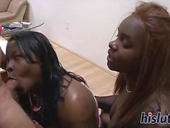 Two ebony BBWs share a white rod