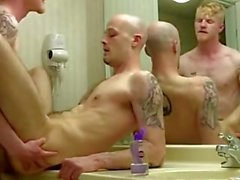 two bad boys fucking in front of the bathroom mirror