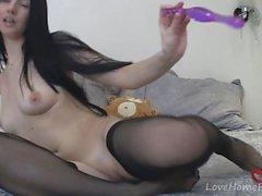 Hot teen in stockings loves her dildo