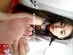 cute chinese girl shows feet
