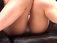 Asian MILF poses on the couch in her underwear reading a sc
