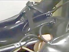 Bound latex babe machine fucked