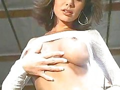 Beautiful Crissy Moran stripping and flashing her busty tits and pink pussy