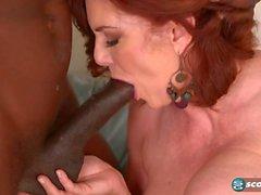 Curvy redhead MILF Andi James gets blacked hardcore interracial porn