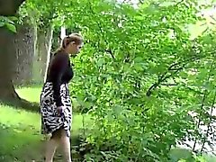 Hot blondes piss standing in a public park