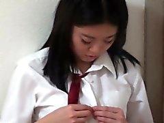 Asian teen rubs watched