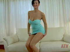 Busty girl Emylia Argan strips to pose topless
