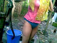 Bangla desi shameless village cousin Nupur bathing outdoor