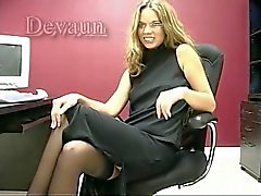 Amazing blonde secretary strips and plays with a dildo at her desk