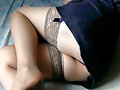 Girl in stockings in a bed