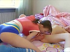 Petite teen lesbos with a dildo