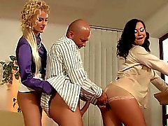 Two raunchy bitches share a massive rod